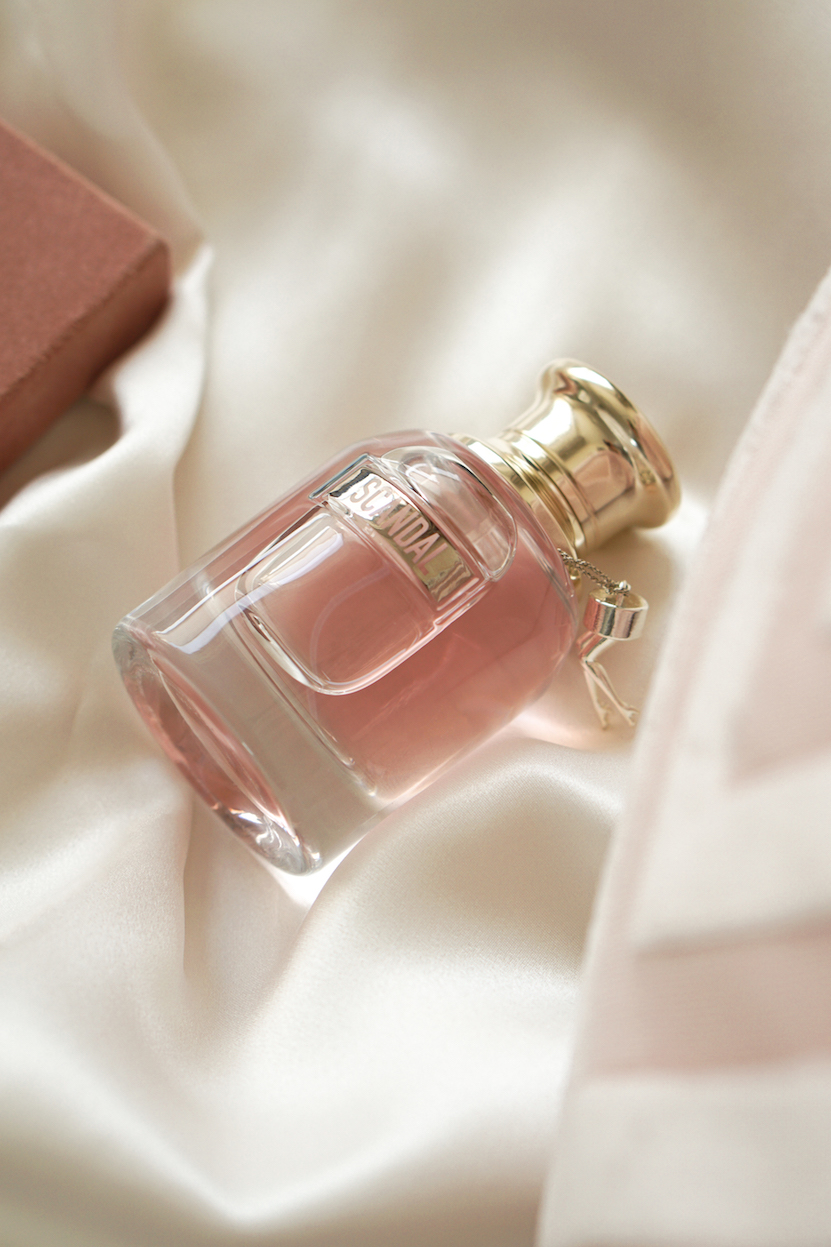 perfume bottle silk flatlay pink beige
