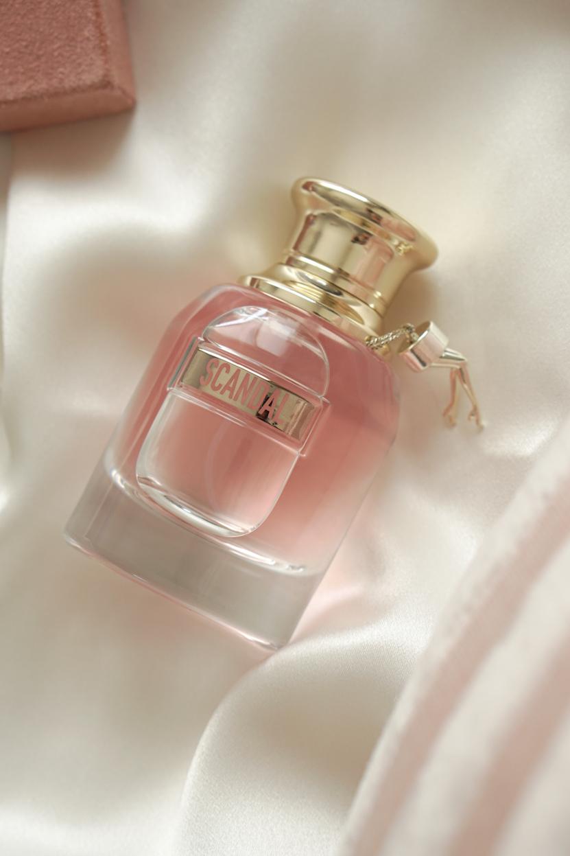 perfume bottle silk flatlay